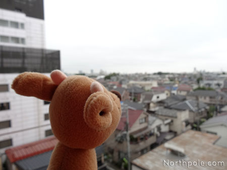 Raymond taking in Tokyo from our balcony in Setagaya