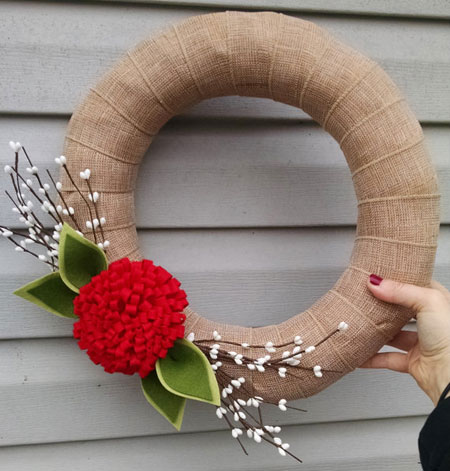 this christmas wreath would be a cheery addition to your front door the burlap wreath is embellished with handmade fabric flowers and leaves