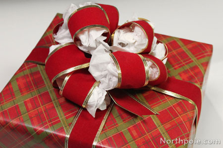Use tissue paper to keep bows looking fluffy year after year.