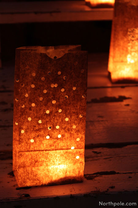 Paper Bag Luminaries: Use a 1/4 inch one-hole punch to cut out dots all over the bag.