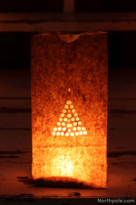 Paper Bag Luminaries: Fold the bag in half and use a 1/4 inch one-hole punch to cut out a polka dot Christmas tree.